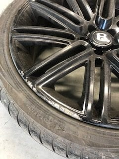 Curbed Bentley alloy
